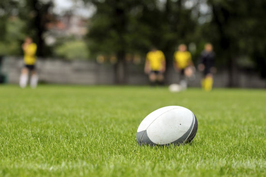 rugby-ball-on-grass.jpg